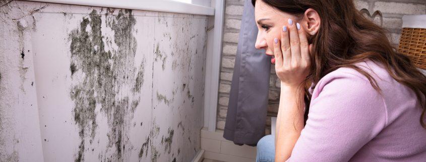 Shocked Woman Looking At Mold mycotoxins